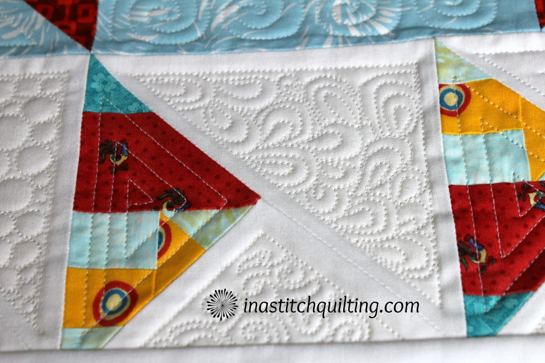 Paisleys, Swirls and Geometric Stitches on Jenny's Quilt