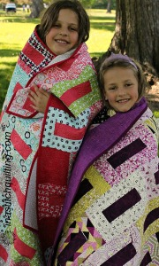 Miss L and Miss M with Quilts