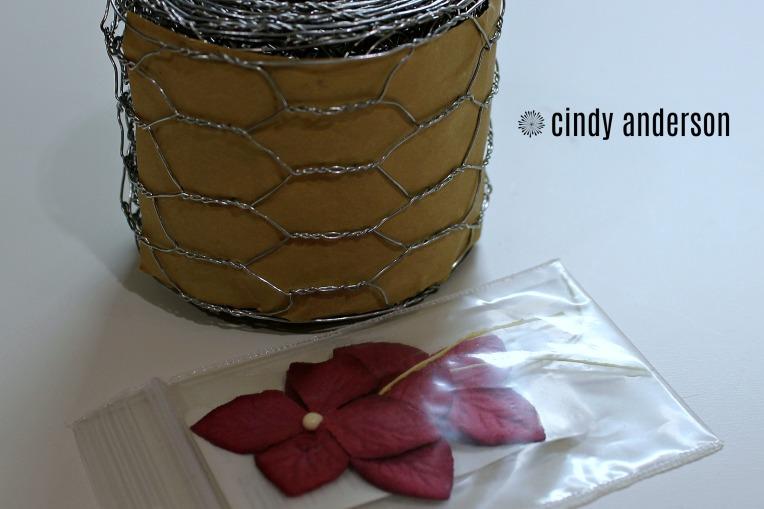 A Roll of Wire and Flowers